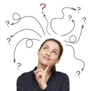 Business woman with arrows and questions sign above isolated on